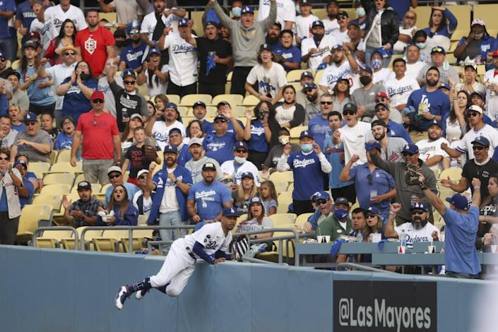The crowd cheers after Los Angeles Dodgers right fielder Mookie Betts makes a catch at the right field wall