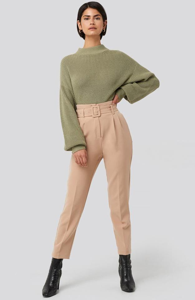 """<p>The silhouette of these <a href=""""https://www.popsugar.com/buy/NA-KD-Belted-Suit-Pants-540405?p_name=NA-KD%20Belted%20Suit%20Pants&retailer=shop.nordstrom.com&pid=540405&price=48&evar1=fab%3Auk&evar9=45887134&evar98=https%3A%2F%2Fwww.popsugar.com%2Ffashion%2Fphoto-gallery%2F45887134%2Fimage%2F47111449%2FNA-KD-Belted-Suit-Pants&list1=shopping%2Cwinter%2Cpants%2Cspring%2Ctrousers%2Cspring%20fashion%2Cwinter%20fashion%2Cfashion%20shopping&prop13=api&pdata=1"""" rel=""""nofollow"""" data-shoppable-link=""""1"""" target=""""_blank"""" class=""""ga-track"""" data-ga-category=""""Related"""" data-ga-label=""""https://shop.nordstrom.com/s/na-kd-belted-suit-pants/5502602/full?origin=category-personalizedsort&amp;breadcrumb=Home%2FWomen%2FClothing%2FPants%20%26%20Leggings&amp;color=beige"""" data-ga-action=""""In-Line Links"""">NA-KD Belted Suit Pants</a> ($48) are so flattering.</p>"""