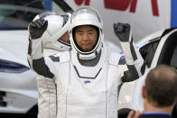 Japan Aerospace Exploration Agency astronaut Soichi Noguchi reacts as he leaves the Operations and Checkout Building with fellow crew members for a trip to Launch Pad 39-A and planned liftoff on a SpaceX Falcon 9 rocket with the Crew Dragon capsule on a six-month mission to the International Space Station Sunday, Nov. 15, 2020, at the Kennedy Space Center in Cape Canaveral, Fla. (AP Photo/John Raoux)