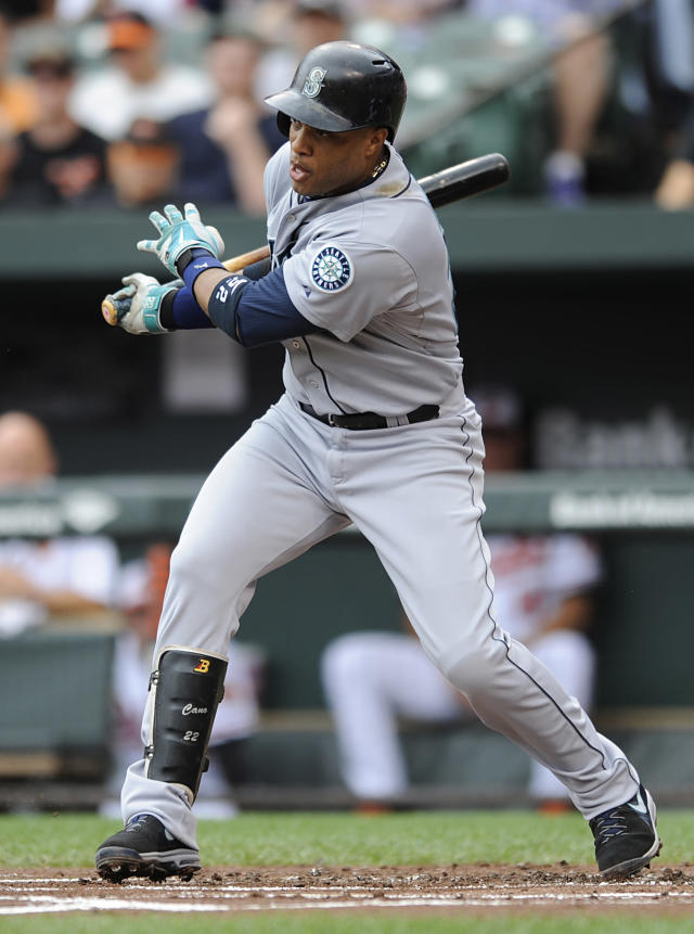 Seattle Mariners' Robinson Cano follows through on a single against the Baltimore Orioles in the first inning of a baseball game Sunday, Aug. 3, 2014, in Baltimore.(AP Photo/Gail Burton)