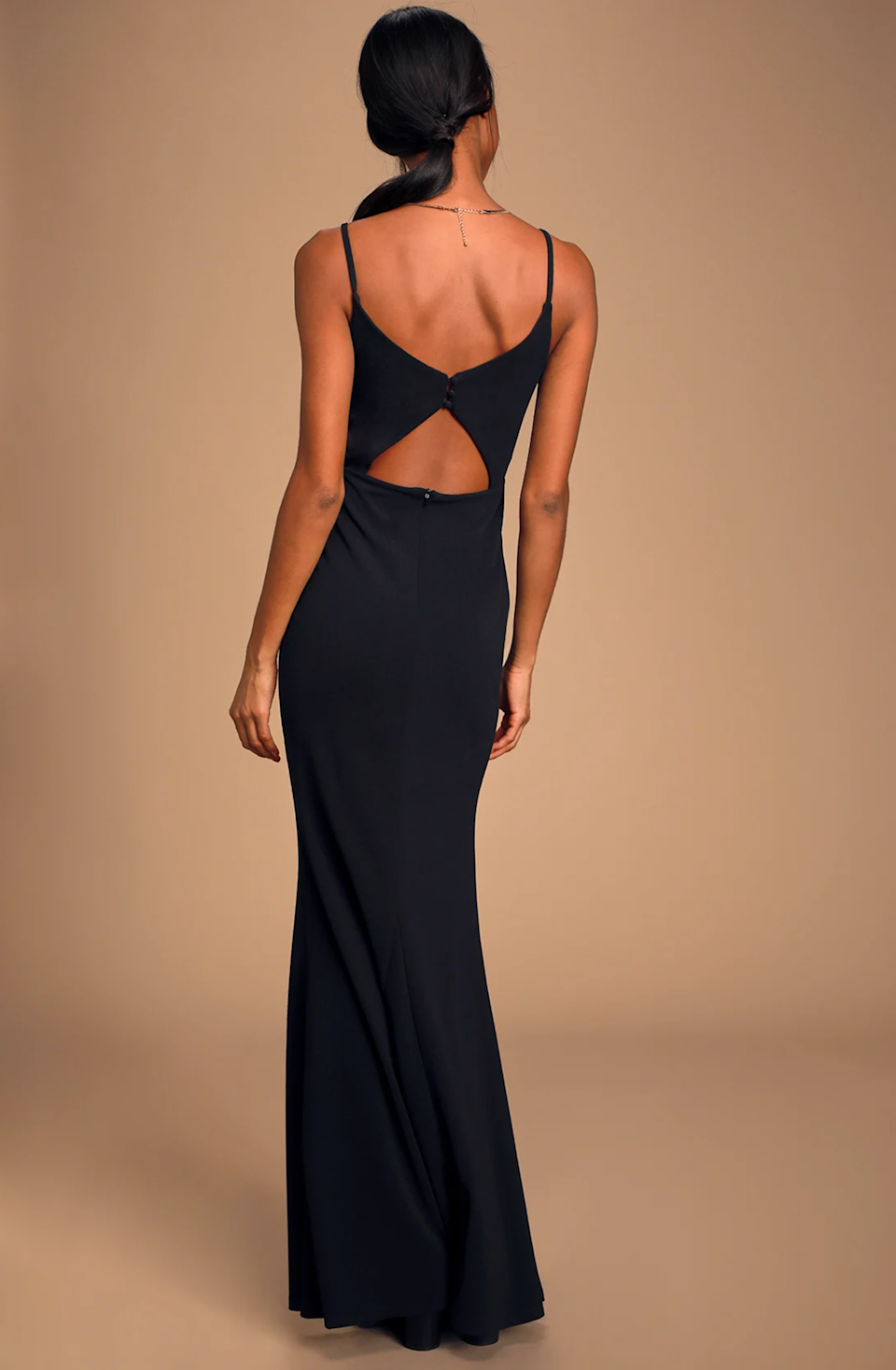 """Lulu's is a gem for cheap bridesmaid dresses, including this stunning cutout maxidress. $88, Lulu's. <a href=""""https://www.lulus.com/products/moments-of-bliss-black-backless-mermaid-maxi-dress/878142.html"""" rel=""""nofollow noopener"""" target=""""_blank"""" data-ylk=""""slk:Get it now!"""" class=""""link rapid-noclick-resp"""">Get it now!</a>"""