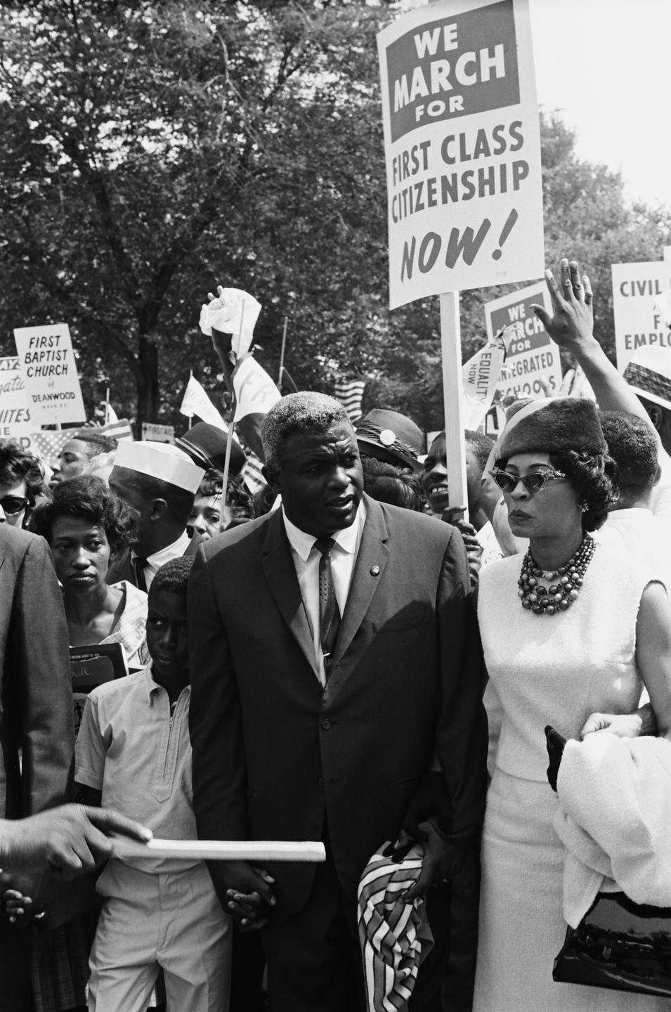 <p>Sixteen years after Jackie Robinson joined Major League Baseball as its first African American player, he attended the March on Washington with his wife, Rachel (right), and his son, David (left). </p>