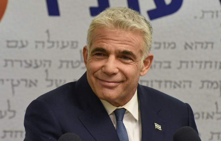 Israel's centrist opposition leader Yair Lapid delivers a statement to the press at the Knesset