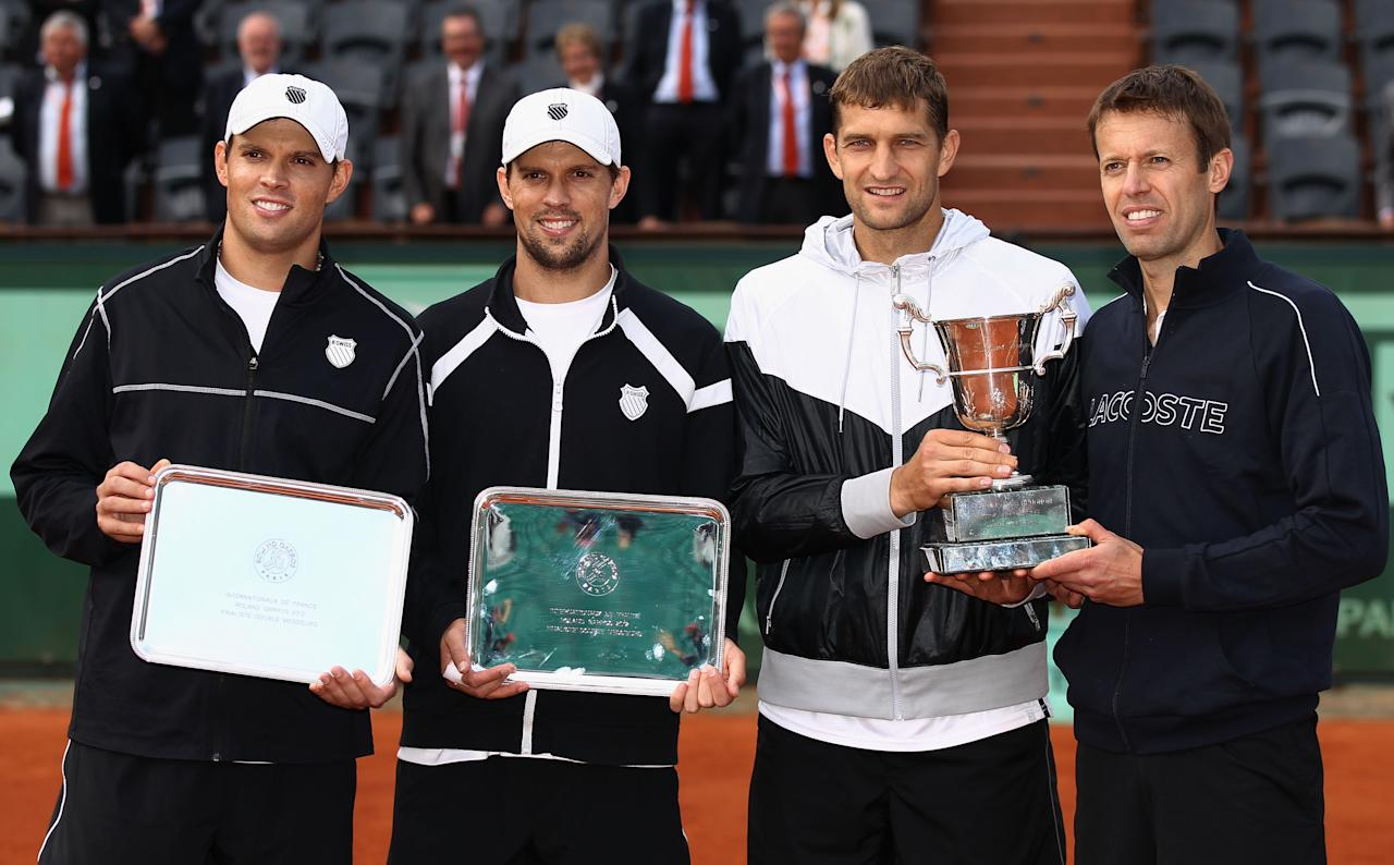 PARIS, FRANCE - JUNE 09: Bob (L) and Mike Bryan of the USA pose with winners Max Mirnyi of Belarus and Daniel Nestor (R) of Canada after the men's doubles final during day 14 of the French Open at Roland Garros on June 9, 2012 in Paris, France.  (Photo by Matthew Stockman/Getty Images)