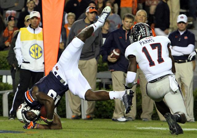 Auburn wide receiver Sammie Coates, left, flips after catching a pass during the first half of an NCAA college football game against Florida Atlantic on Saturday, Oct. 26, 2013, in Auburn, Ala. (AP Photo/Butch Dill)