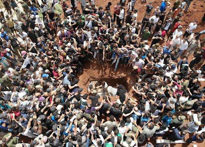 Hundreds came for a last glimpse of the young Syrian fighter who was laid to rest (AFP Photo/OMAR HAJ KADOUR)