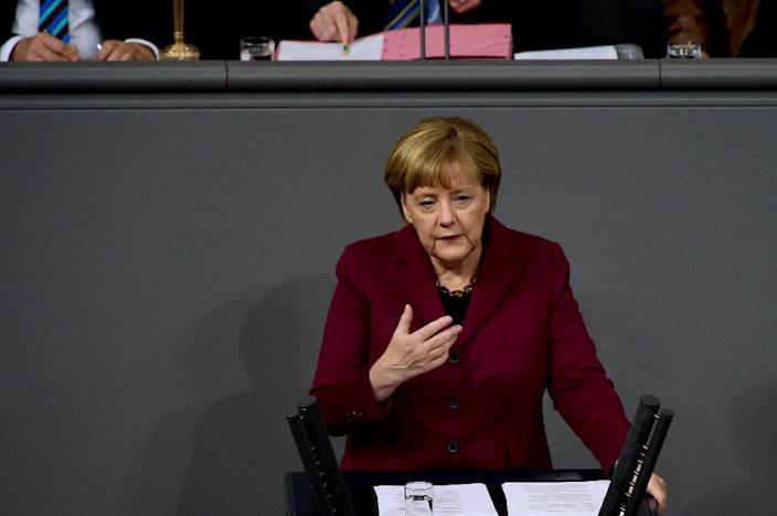 German Chancellor Angela Merkel addresses members of the lower house of Parliament during a speech on the refugee crisis ahead of an EU summit, on October 15, 2015 in Berlin (AFP Photo/John MacDougall)