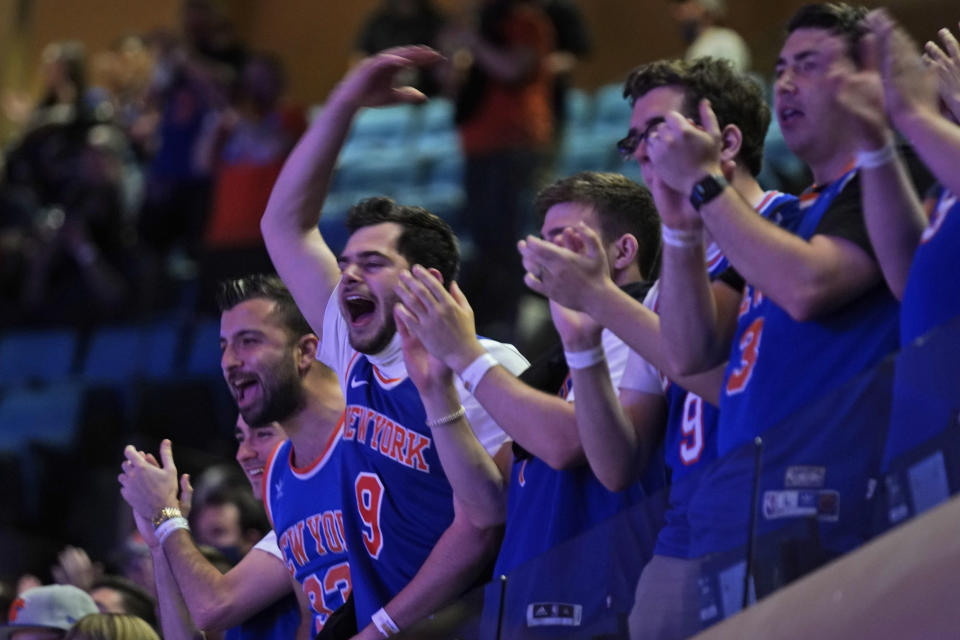 New York Knicks fans cheer before Game 1 of an NBA basketball first-round playoff series against the Atlanta Hawks, Sunday, May 23, 2021, in New York. (AP Photo/Seth Wenig, Pool)