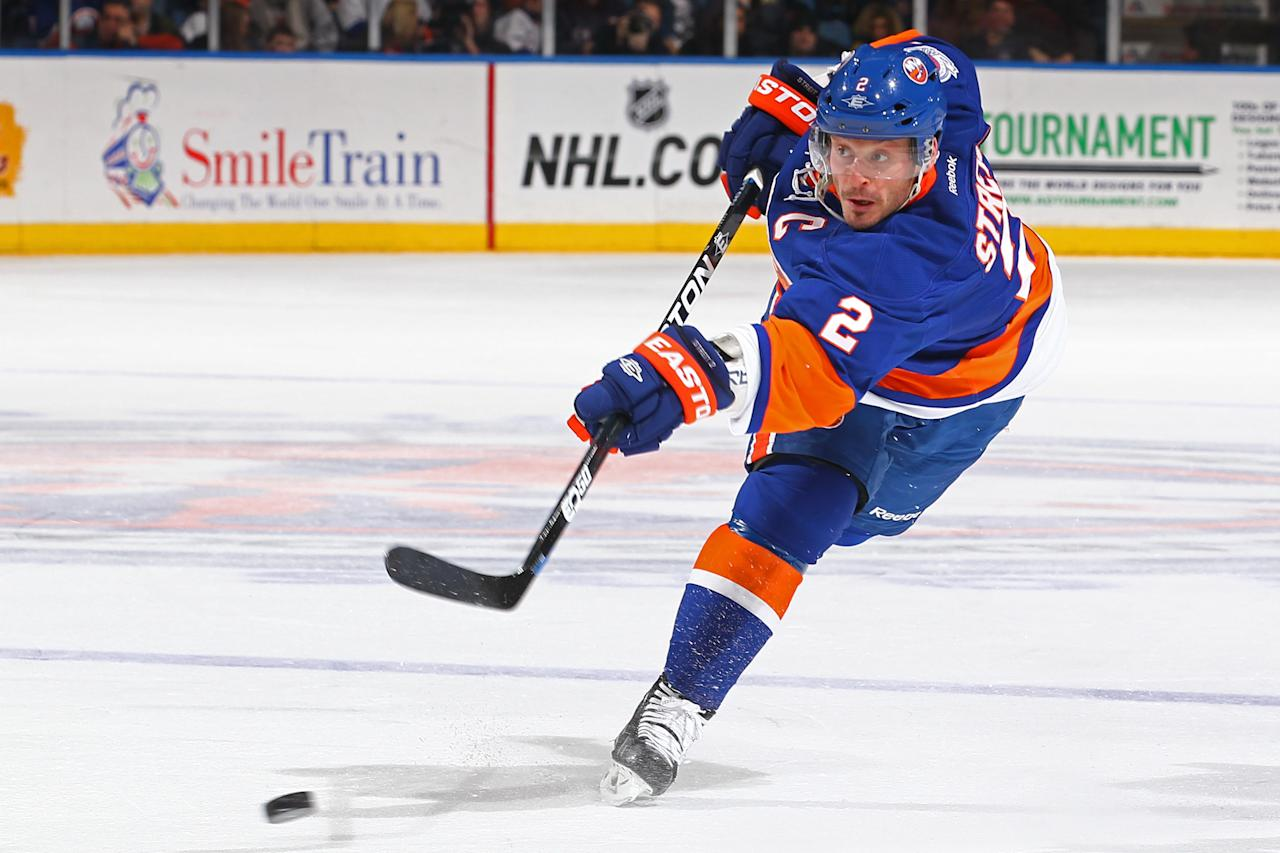 UNIONDALE, NY - FEBRUARY 12:  Mark Streit #2 of the New York Islanders shoots the puck against the Florida Panthers during their game on February 12, 2012 at the Nassau Coliseum in Uniondale, New York.  (Photo by Al Bello/Getty Images)