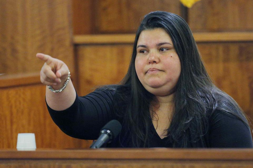 House cleaner Carla Barbosa points to former New England Patriots player Aaron Hernandez, as she testifies in his murder trial at Bristol County Superior Court in Fall River, Massachusetts, February 24, 2015. Hernandez is accused of the murder of Odin Lloyd in June 2013. REUTERS/Brian Snyder (UNITED STATES - Tags: CRIME LAW SPORT FOOTBALL)