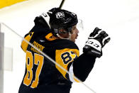 Pittsburgh Penguins' Sidney Crosby celebrates his overtime goal in the team's NHL hockey game against the Washington Capitals in Pittsburgh, Tuesday, Jan. 19, 2021. The Penguins won 5-4. (AP Photo/Gene J. Puskar)