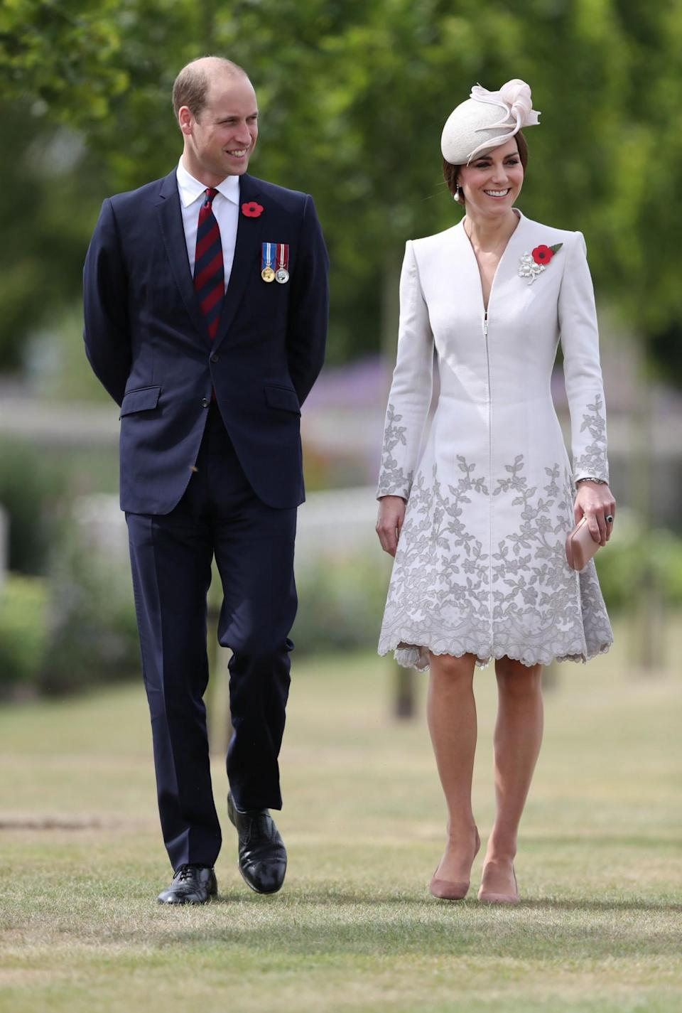 <p>The Duke and Duchess of Cambridge visit the final resting place of 5,000 World War One servicemen for the 100-year anniversary of Passchendaele. For the occasion, the Duchess wore an embroidered coat dress with a matching hat and a poppy brooch. <em>[Photo: PA]</em> </p>
