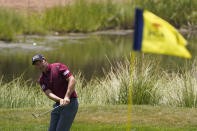 Pádraig Harrington, of Ireland, chips to the first green during the third round at the PGA Championship golf tournament on the Ocean Course, Saturday, May 22, 2021, in Kiawah Island, S.C. (AP Photo/Chris Carlson)