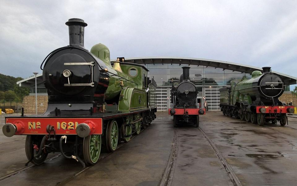 steam trains outside modern museum building