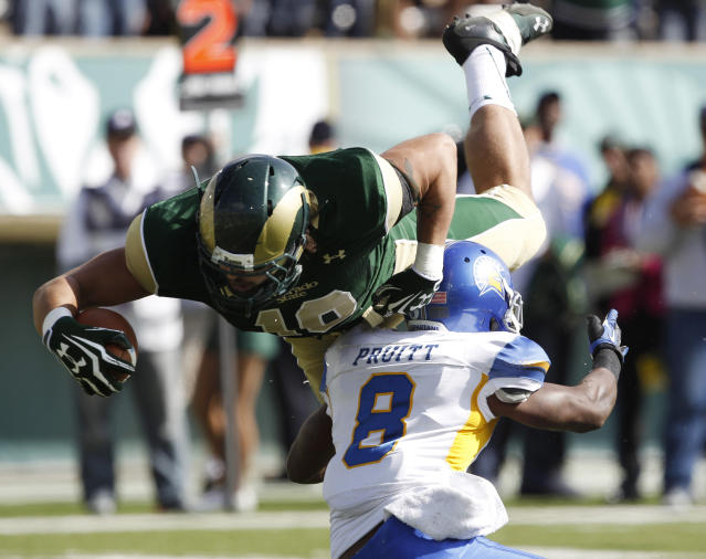 Colorado State tight end Crockett Gilmore, top, bowls over San Jose State cornerback Jimmy Pruitt to score a touchdown after pulling in a pass in the first quarter of an NCAA college football game in Fort Collins, Colo., on Saturday, Oct. 12, 2013. (AP Photo/David Zalubowski)