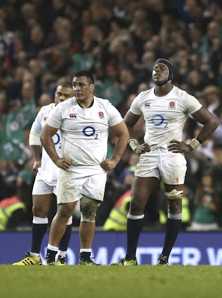 England's Billy Vunipola, left, and, Maro Itoje, react after the final whistle following the Six Nations rugby union international match between Ireland and England at the Aviva stadium in Dublin, Ireland, Saturday, March 18, 2017. England won the Six nations Championship, but lost their last game to Ireland 13-6. (AP Photo/Peter Morrison)