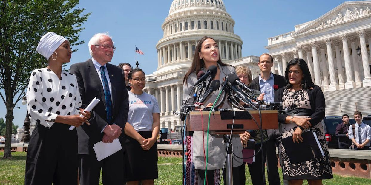From left, Rep. Ilhan Omar, D-Minn., Democratic presidential candidate, Sen. Bernie Sanders, I-Vt., and Rep. Pramila Jayapal, D-Wash., far right, listen as Rep. Alexandria Ocasio-Cortez, D-N.Y., center, joins them in a call for legislation to cancel all student debt.
