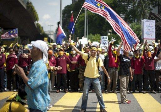A protestor waves the Malaysian national flag during an anti-government protest in Kuala Lumpur on April 28, 2012. Malaysian clerics have issued a fatwa against demonstrations, days after Prime Minister Najib Razak said a quashed election reform rally was being used to topple the government ahead of polls