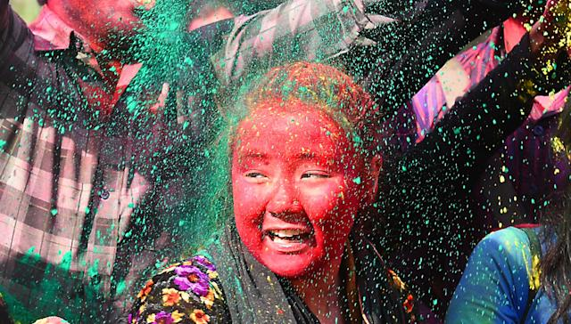 <p>Students celebrate the Holi festival on March 1, 2018 in New Delhi, India. (Photo: Raj K. Raj/ Hindustan Times via Getty Images) </p>