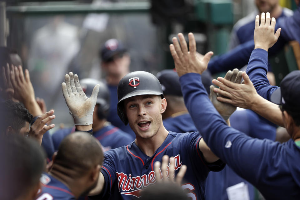 Minnesota Twins' Max Kepler, center, celebrates his two-run home run with teammates in the dugout during the seventh inning of the team's baseball game against the Los Angeles Angels on Thursday, May 23, 2019, in Anaheim, Calif. (AP Photo/Marcio Jose Sanchez)
