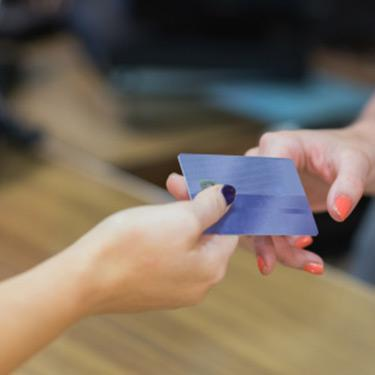 Woman-handing-over-credit-card_web