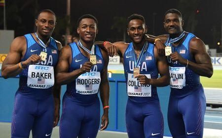 Apr 22, 2017; Nassau, Bahamas; Members of the United States 4 x 100m relay (from mleft): Ronnie Backer and Michael Rodgers and Leshon Collins and Justin Gatlin pose after winning in 38.43 during the IAAF World Relays at Thomas A. Robinson Stadium. Mandatory Credit: Kirby Lee-USA TODAY Sports