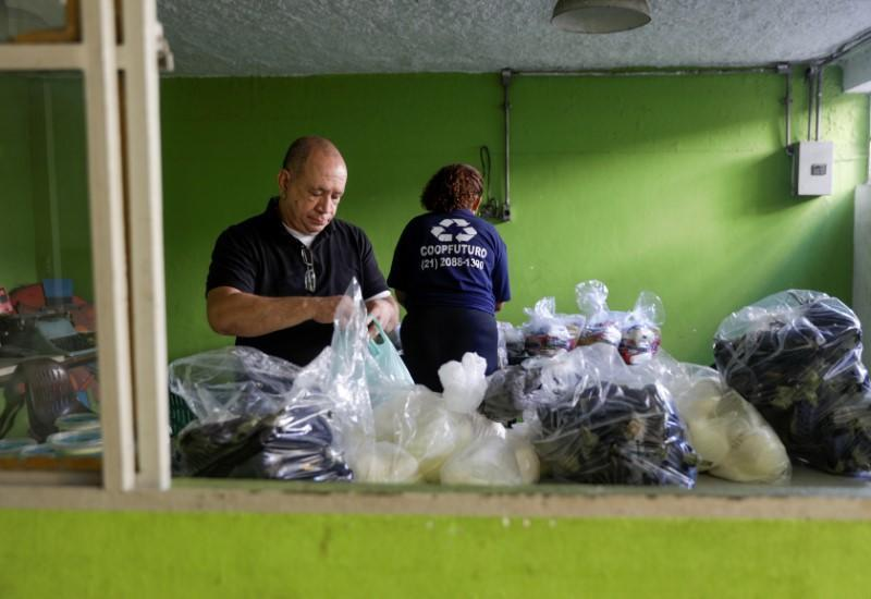 Luiz Carlos Fernandes, president of Coopama, a waste recycling cooperative, prepares donations to deliver to garbage collectors after they stopped working during the coronavirus disease (COVID-19) outbreak, in Rio de Janeiro