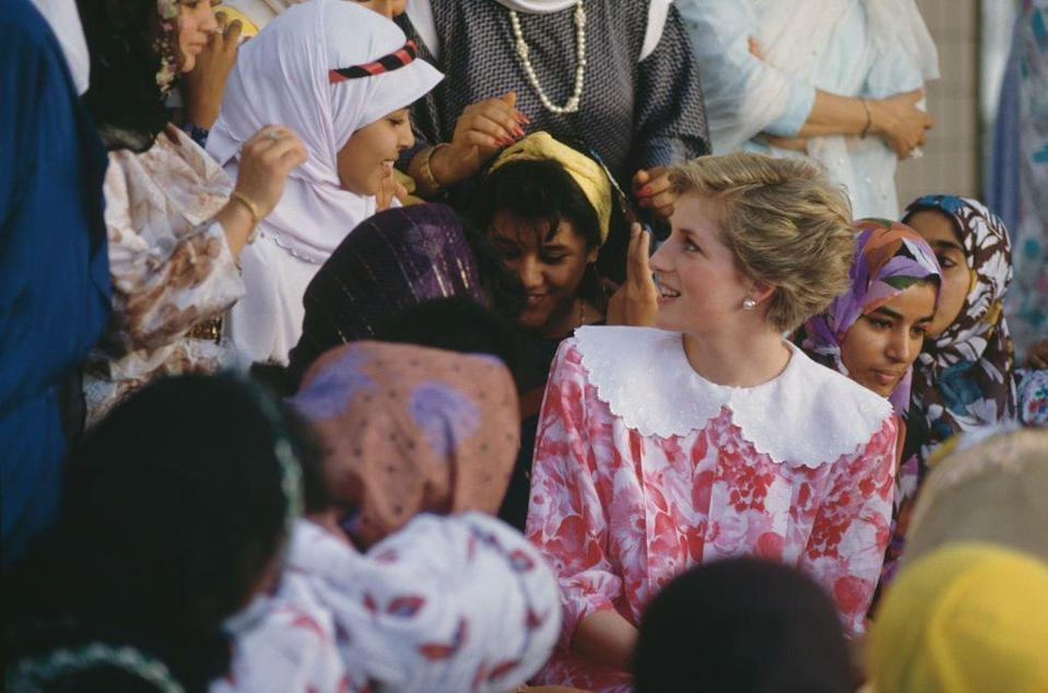 <p>On a visit to Sultan Qaboos University in Muscat, Oman, Princess Diana wore a dress by Paul Costelloe embellished with a rounded oversize collar in November 1986.</p>