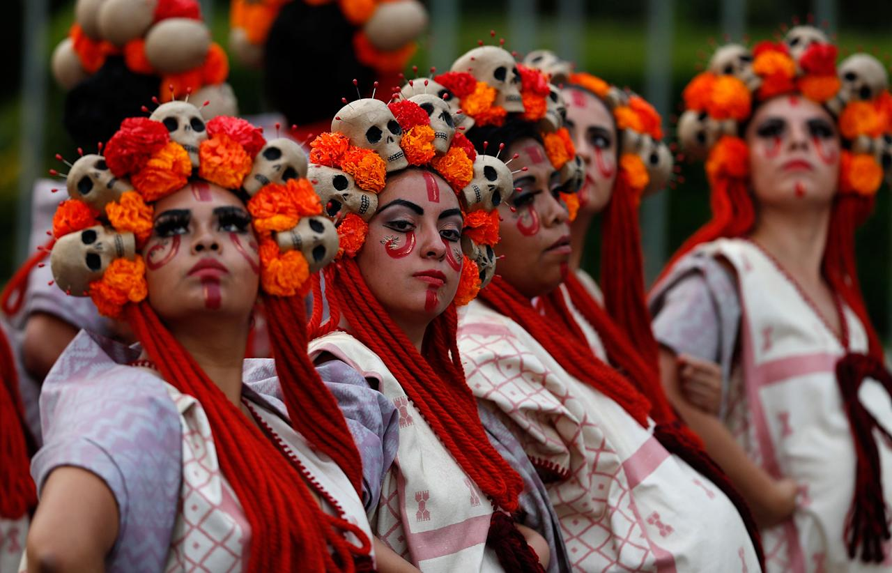 "<p>Performers participate in the Day of the Dead parade on Mexico City's main Reforma Avenue, Saturday, Oct. 28, 2017. Mexico's capital is holding its Day of the Dead parade, an idea actually born out of the imagination of a scriptwriter for the James Bond movie ""Spectre."" (Photo: Eduardo Verdugo/AP) </p>"