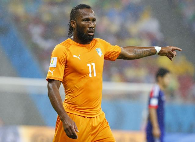 Ivory Coast's Didier Drogba gestures during their 2014 World Cup Group C soccer match against Japan at the Pernambuco arena in Recife, June 14, 2014. REUTERS/Stefano Rellandini (BRAZIL - Tags: SOCCER SPORT WORLD CUP)
