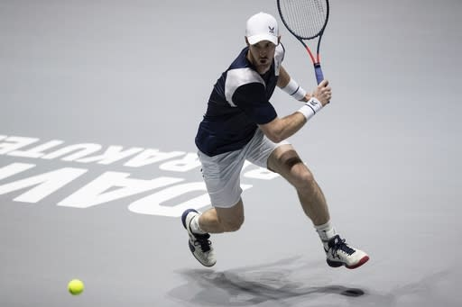 Great Britain's Andy Murray returns the ball to Netherlands' Tallon Griekspoor during their Davis Cup tennis match in Madrid, Spain, Wednesday, Nov. 20, 2019. (AP Photo/Bernat Armangue)