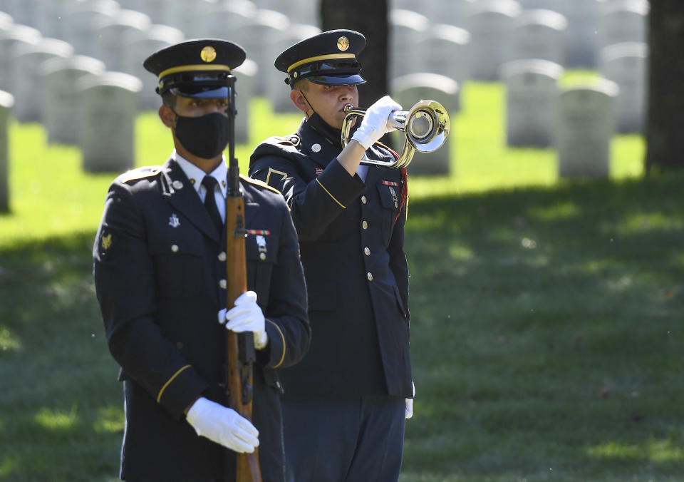 A Honor Guard plays Taps for Korean War veteran Army Cpl. Walter Smead, a member of Battery A, 57th Field Artillery Battalion, 7th Infantry Division who was killed during the 1950 Battle of the Chosin Reservoir, is laid to rest with full military honors at Gerald B. H. Solomon Saratoga National Cemetery, on Monday, Sept. 20, 2021, in Schuylerville, N.Y. Korean War veteran Army Cpl. Walter Smead, a member of Battery A, 57th Field Artillery Battalion, 7th Infantry Division who was killed during the 1950 Battle of the Chosin Reservoir, is laid to rest with full military honors at Gerald B. H. Solomon Saratoga National Cemetery, on Monday, Sept. 20, 2021, in Schuylerville, N.Y. Smead was finally laid to rest near his rural upstate New York hometown, seven decades after he was killed in the Korean War and months after his remains were finally identified with help from DNA analysis. (AP Photo/Hans Pennink)