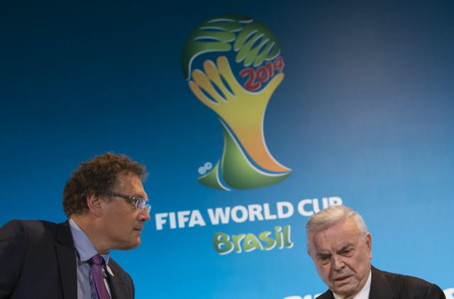 FIFA Secretary General Jerome Valcke, left, and President of Brazilian Soccer Confederation Jose Maria Marin arrive for a news conference at the Maracana stadium in Rio de Janeiro, Brazil, Thursday, March 27, 2014. (AP Photo/Felipe Dana)