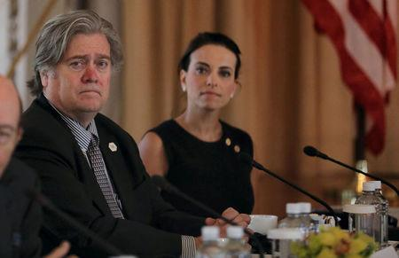 White House Chief Strategist Steve Bannon (L) listens with U.S. Deputy National Security Advisor for Strategy Dina Powell (R) during a bilateral meeting between U.S. President Donald Trump and China's President Xi Jinping at Trump's Mar-a-Lago estate in Palm Beach, Florida, U.S., April 7, 2017. REUTERS/Carlos Barria