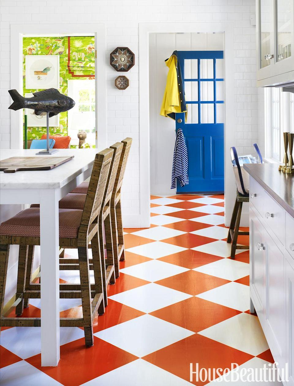 "<p>An <span class=""redactor-unlink"">orange checkerboard floor brightens up this </span> <a href=""https://www.housebeautiful.com/room-decorating/kitchens/g3223/white-kitchen-ideas/"" rel=""nofollow noopener"" target=""_blank"" data-ylk=""slk:mostly white kitchen"" class=""link rapid-noclick-resp"">mostly white kitchen</a> by Gary McBournie, while the contrasting blue door adds a quirky touch. Translation: Loosen up and opt for bold colors. </p>"