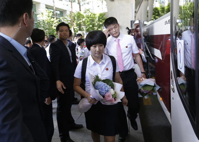 North Korea's table tennis players get into a bus upon their arrival at the Incheon International Airport in Incheon, South Korea, Sunday, July 15, 2018. North Korean table tennis players arrived in South Korea on Sunday to compete in an international tournament amid an atmosphere of detente between the rivals. (AP Photo/Ahn Young-joon)