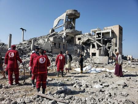 Red Crescent medics stand at the site of Saudi-led air strikes on a Houthi detention centre in Dhamar
