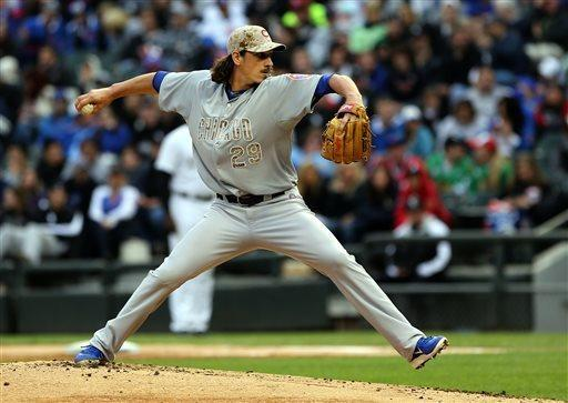 Chicago Cubs starting pitcher Jeff Samardzija pitches to the Chicago White Sox in the first inning in a baseball game in Chicago on Monday, May 27, 2013. (AP Photo/Charles Cherney)