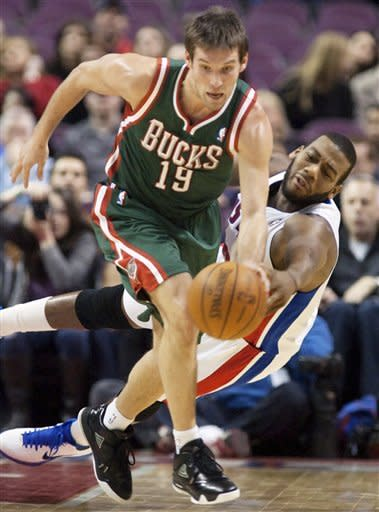 Detroit Pistons' Greg Monroe, right, knocks the ball away from Milwaukee Bucks' Beno Udrih (19) in the first half of an NBA basketball game on Friday, Feb. 3, 2012, in Auburn Hills, Mich. The Pistons defeated the Bucks 88-80. (AP Photo/Duane Burleson)