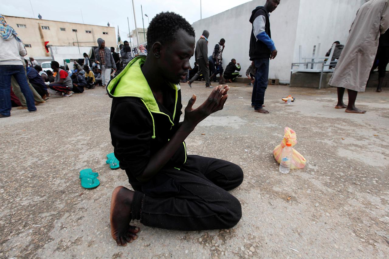 An illegal African migrant prays at a detention camp in Tripoli, Libya, March 22, 2017. REUTERS/Ismail Zitouny