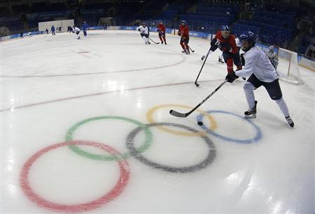 Finland's national women's ice hockey team take part in a training session at Shayba Arena in preparation for the 2014 Sochi Winter Olympics