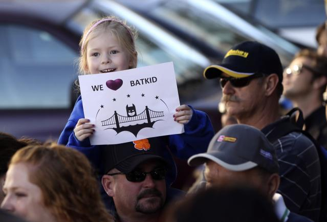 """Kayla Fry holds a sign as she waits to see five-year-old leukemia survivor Miles, aka """"Batkid"""", as part of a day arranged by the Make-A-Wish Foundation in San Francisco, California November 15, 2013. Miles will be treated to various super hero scenarios including receiving a commendation at San Francisco City Hall. REUTERS/Robert Galbraith (UNITED STATES - Tags: SOCIETY)"""