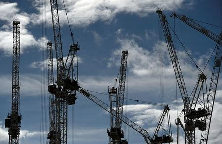 FILE PHOTO: Construction cranes are seen on a building site in central London