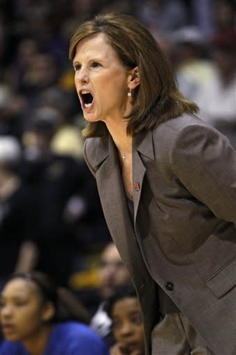 Kansas head coach Bonnie Henrickson shouts instructions to her team in the first half of a first-round women's NCAA college basketball game against Colorado, Saturday, March 23, 2013, in Boulder, Colo. (AP Photo/ Brennan Linsley )