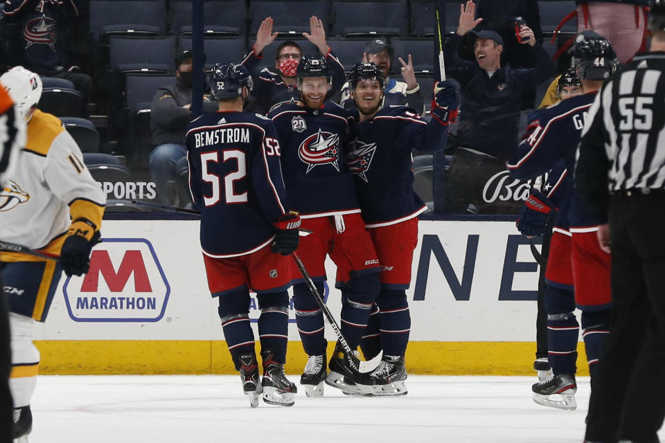 Columbus Blue Jackets' Mikhail Grigorenko, center, celebrate his goal against the Nashville Predators with Emil Bemstrom, left, and Jack Roslovic during the third period of an NHL hockey game Wednesday, May 5, 2021, in Columbus, Ohio. The Blue Jackets won 4-2. (AP Photo/Jay LaPrete)