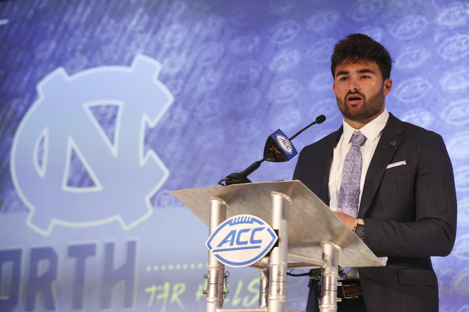 North Carolina quarterback Sam Howell answers a question during the NCAA college football Atlantic Coast Conference media days in Charlotte, N.C., Wednesday, July 21, 2021. (AP Photo/Nell Redmond)