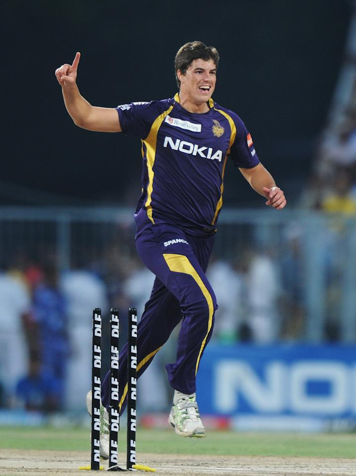 Kolkata Knight Riders bowler Marchant de Lange celebrates after taking the wicket of Pune Warriors India batsman Michael Clarke during the IPL Twenty20 cricket match between Kolkata Knight Riders and Pune Warriors at The Eden Gardens in Kolkata on May 5, 2012.  RESTRICTED TO EDITORIAL USE. MOBILE USE WITHIN NEWS PACKAGE.  AFP PHOTO/Dibyangshu SARKAR        (Photo credit should read DIBYANGSHU SARKAR/AFP/GettyImages)