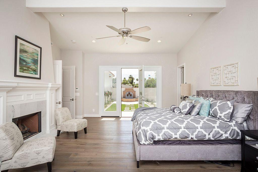 <p>The master bedroom, with French doors leading to a serene outdoor space, offers some of the chicest sleeping quarters we've seen. </p>