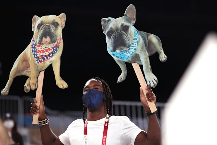 TOKYO, JAPAN – AUGUST 03: A member of the crowd holds signs with dogs during the Women's Balance Beam Final on day eleven of the Tokyo 2020 Olympic Games at Ariake Gymnastics Centre on August 03, 2021 in Tokyo, Japan. (Photo by Laurence Griffiths/Getty Images)