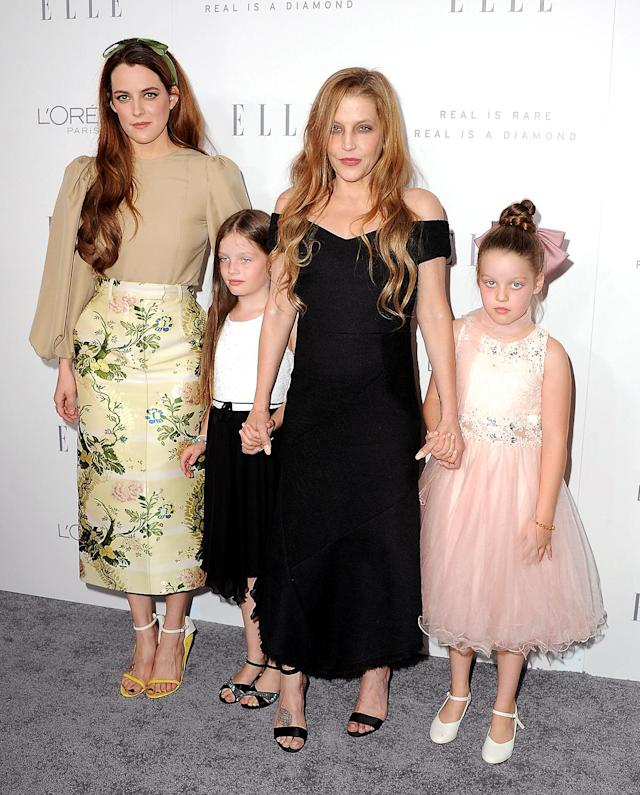 <p>Despite her many ups and downs, Lisa Marie is a survivor. In October, she hit the red carpet with her girls — Riley, Harper, and Finley — for an <em>Elle</em> event at the Four Seasons in L.A. Here's to 50 more years. (Photo: Jon Kopaloff/FilmMagic) </p>